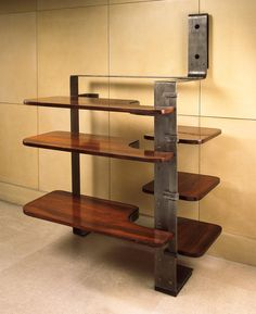 Pierre Chareau, Nickel Patinated Iron and Palissander Shelving Unit, c1930.