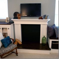 Build a fake fireplace for the center chimney wall in the dining room!