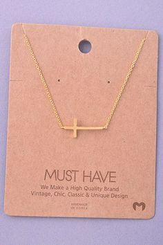 side cross necklace in gold