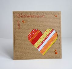 kraft card with heart negative die cut space filled with ribbon stripes...like the design and luv the ribbons...