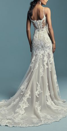 Wedding Dress by Maggie Sottero - ABBIE MARIE, Embroidered lace motifs and crosshatching dance over the illusion fit-and-flare skirt in this sexy bridal gown. See more gorgeous bridal gowns by clicking on the photo Fit And Flare Wedding Dress, Black Wedding Dresses, Princess Wedding Dresses, Designer Wedding Dresses, Bridal Dresses, Wedding Gowns, Wedding Ceremony, Illusion Wedding Dresses, Fitted Lace Wedding Dress