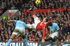 Rooney scoring against Manchester City