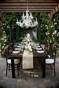 Chandelier in backyard dining room