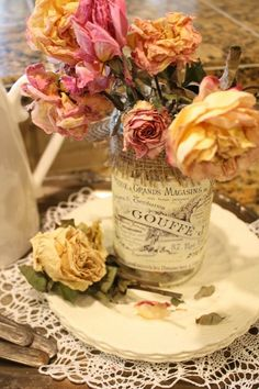 Dried roses in an embellished jar