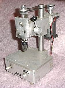 Mini Drill Press - Homemade mini drill press constructed from aluminum plate and featuring a 1