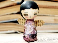 Beeswax covered wood doll