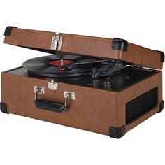 """Indulge in mid-century style with this eye-catching essential, an enviable addition to your well-appointed home.   Product: TurntableConstruction Material: Metal and plasticColor: TanFeatures:  Three speed belt drivenPlays 33, 45, 78 RPM recordsDynamic full range stereo speakers Dimensions: 7"""" H x 17"""" W x 11"""" D"""