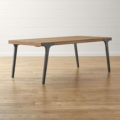 Shop Lakin Recycled Teak Extendable Dining Table.   Antiqued to get the look of cast iron, Lakin's metal legs seamlessly integrate with the table's wood apron, angling out for maximum style and legroom.