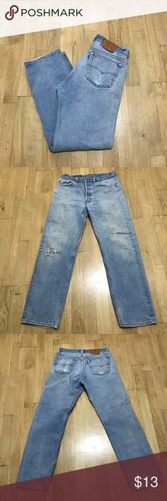 Levi Strauss Jeans Worn with love, plenty of life left. Size is worn off of the tag. Holes are original, not from wear. Length is 33 Levi's Jeans Relaxed