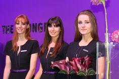 Trois hôtesses de l'agence Charlestown au Mondial de l'Auto à Paris en 2013