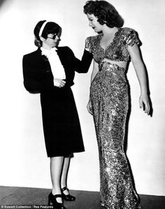 """1944. 8-time Oscar Winning Costume Designer, Edith Head, tweaks Betty Hutton's costume for 'Here Comes the Waves.'  Yes, she won EIGHT OSCARS and was nominated for more than 25 - more than any other person - woman OR man.  Head wrote:  """"How to Dress for Success by Edith Head"""" with Joe Hyams, in the 1960s."""