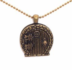 This isn't just a hobbit hole necklace (which is awesome in and of itself) it's also a locket!  I love love love it. If someone found this and bought if for me, I would seriously love them forever and ever. Nerd side coming out..