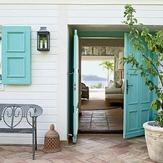 Double Entry Doors < Ideas for Creating an Inviting Entryway - Coastal Living Coastal Homes, Coastal Living, Coastal Cottage, White Cottage, Coastal Style, Coastal Decor, Turquoise Door, Aqua Door, Turquoise Accents