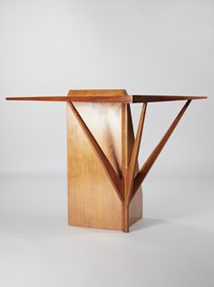 Ico Parisi corner console table. Wall mounted corner console table designed for a private residence. Tapered veneered surfaces and shaped vertical walnut elements.