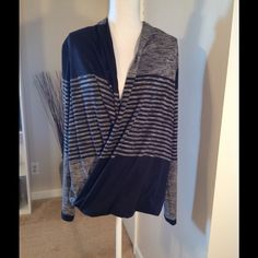 **SOLD**Max Studio Faux Wrap Sweater Brand New This is a Max Studio faux wrap black and gray long sleeve sweater.  Never worn, brand new but no tag.  77% polyester, 18% rayon, 5% spandex.  Very soft and not overly thick. Gorgeous sweater.  Comes mid hip. Max Studio Sweaters