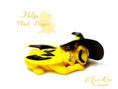 Wizard Dragon series.  This pretty sculpture of a sleeping dragon was inspired by the character of Helga Hufflepuff. She has a vivid yellow body with black wings, a bright green star-shaped rhinestone on her forehead, golden glitter on her eyelids and tail and a little, wearable witch hat. Enti...