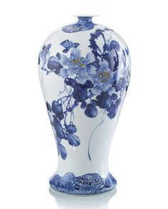 "20""Hx9""D. A gallery sized blue and white porcelain jar with a flower motif and yellow accents. Crisp and fresh."