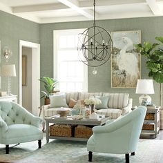 dramatic living rooms | dramatic light fixture, the Orb Chandelier, takes this living room ...
