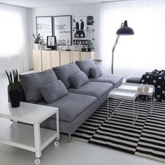 Scandinavian living room with IKEA STOCKHOLM rug + cart