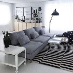 Scandinavian living room with IKEA STOCKHOLM rug + cart