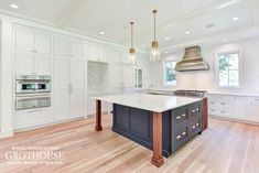 Traditional Kitchen Design with White Perimeter Cabinets, Blue Island Cabinets and a Walnut Waterfall Countertop Designed by Amanda Needham in McLean, VA Mclean Virginia, Waterfall Countertop, Blue Cabinets, Wood Countertops, Traditional Kitchen, Walnut Wood, Kitchen Design, Home Decor, Image