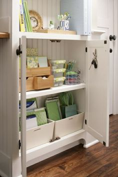 Love this cabinet organization for office supplies, papers and odds and ends via reddoorhome.blogspot.com