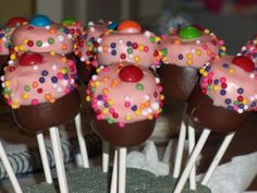 Candyland pops: marshmallows dipped in chocolate, then colored chocolate or yogurt, & topped w/ sprinkles