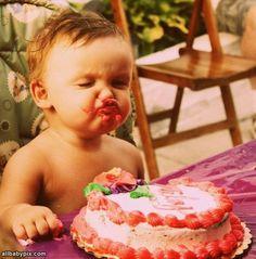 Baby loves birthday cake.