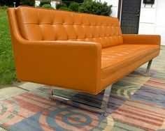 Orange sofa...check out the legs