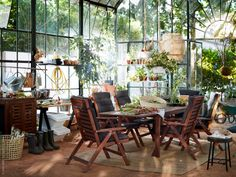 Conservatory greenhouse with lots of plants and an outdoor dining table! Ikea Outdoor Table, Ikea Table, Outdoor Dining Furniture, Wooden Dining Tables, Outdoor Spaces, Outdoor Decor, Conservatory Dining Room, What Is A Conservatory, Greenhouse Interiors