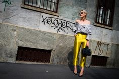 Sofie Valkiers, Street Style: Milan Fashion Week Spring 2017: Yellow Pant, Black Structured Bag, Grey Wrap Top | coveteur.com