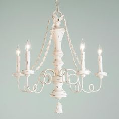 Shabby Cream Draping Garlands Chandelier Graceful garlands drape down on this 5 light chandelier and a tassel embellishes the bottom. Distressed shabby cream finish gives it vintage chic appeal.