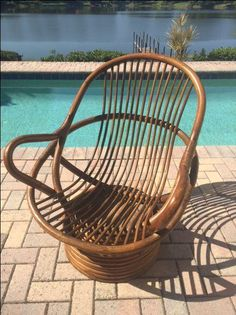 Vintage Rattan Swivel Rocking Chair On Chairish.com