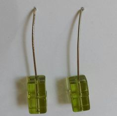 Cute little translucent green cubes are stacked on top of each other on silver-plated 45 degree earring wire. Silver Plate, Drop Earrings, Cubes, Green, Top, Silverware Tray, Dice, Dangle Earrings, Drop Earring