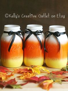 If scary Halloween decor isn't your thing opt for a more kid-friendly approach with this candy corn-colored trio of Mason jars. If scary Halloween d Mason Jar Projects, Mason Jar Crafts, Mason Jar Diy, Bottle Crafts, Diy Projects, Fall Mason Jars, Christmas Mason Jars, Christmas Tables, Holiday Tables