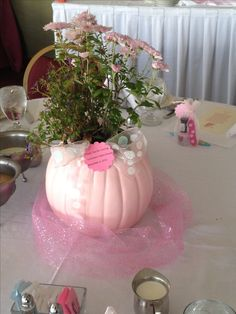 Cute fall baby shower idea!!! Spray paint white pumpkins and add glitter then put in mums with a ribbon.