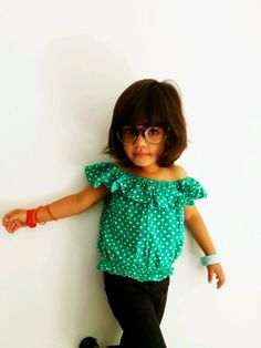 Style your daughter this summer in this cotton off shoulder top. It has a lovely green colour.You can pair it up with skirt or pant. Explore more girls smart wear options at Foreverkidz.