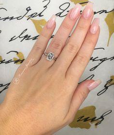 Raineri Jewelers Custom Made White Gold Diamond Engagement Ring With a Emerald Cut Diamond Center Stone