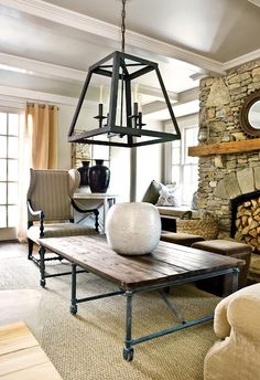 Rustic Meets Industrial Family Room ~ I especially love the Fireplace, Coffee Table and Lantern Lighting.