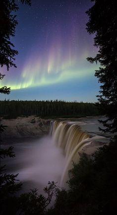 ~~Showers of Aurora above Alexandra Falls by Adam Hill ~~