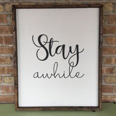Stay Awhile wood sign.  This black and white Stay Awhile sign comes with a stained frame. It would look great in your home with any decor!  Dimensions: appox 23x28  All of my wooden signs are stained and hand painted. No two are identical. Please note that since this sign is made of wood there are unavoidable knots that add character to the piece :).  HANGING HARDWARE IS INCLUDED ON THIS SIGN  This item is ready to ship and will ship 1-2 business days.