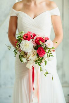 red and pink bouquet - photo by Sara and Rocky Photography http://ruffledblog.com/stylish-and-light-fall-wedding