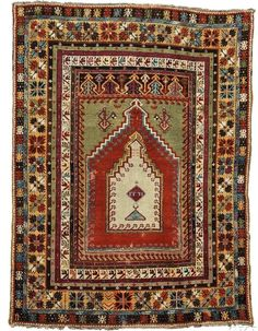 "Kirshehir Prayer Rug, West Anatolia, third quarter 19th century, the mint green field within a light red field under a stepped mihrab, cross panel with polychrome double arrowhead design at top, all within a gold ""shobokli"" border, several highly stylized geometric and floral minor borders, 5 ft. 8 in. x 4 ft. 3 in."