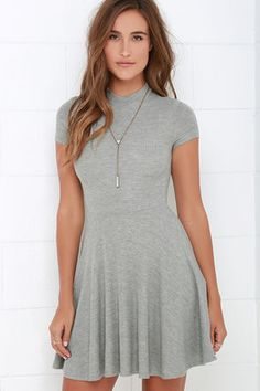 When you're looking to wear something so comfy that you can wear it all day and through the night, pick the Endless Entertainment Grey Short Sleeve Skater Dress! Soft and lightweight ribbed knit fabric shapes a mock neckline and short sleeves that frame a fitted bodice and waistline. From there, a flouncy skater skirt descends, perfect for a twirl on the dance floor! Dress is lined; sleeves are not. 91% Rayon, 9% Spandex. Dry Clean Only. Made With Love in the U.S.A.