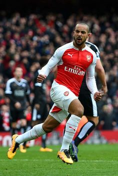 Theo Walcott wheels off in celebration after scoring a goal against Leicester City in February 2016...