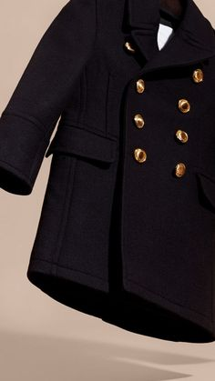 A tailored Burberry coat in a wool-cashmere blend. The classic shape is framed with a revere collar and military gold-toned domed buttons, and is designed to layer easily with both formal and casual looks.