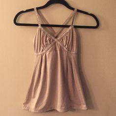 "LULULEMON Dance: Strap Tank Gorgeous champagne colored tank with straps that cross behind the back. Lower cut with loose bodice that has a drawstring at hem. Good used condition.  Laid flat bust measured 15"", at narrowest point measured 11.25"". lululemon athletica Tops Tank Tops"