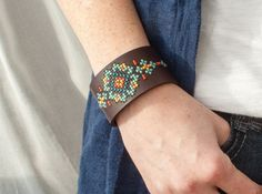 Cross stitch like youve never seen it! This hand-stitched leather cuff is easy-to-wear and looks great with jeans and a t-shirt or something fancier. Its a go-to piece I find myself wearing just about every day. This DIY kit makes stitching simple. Each cuff comes with the holes pre-punched, so all you have to do is follow the pattern. The kit includes four different patterns and enough embroidery floss to stitch any one of them, so you can choose your favorite. Best of all, the cuff works…