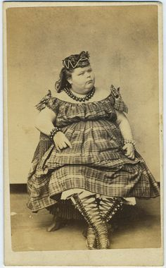 Albumen photograph carte de visite of a circus side show of the large lady Amelia Hill, dressed in plaid gown with matching plaid cap and ornately laced boots. (c. 1867)
