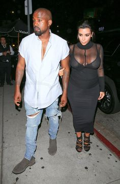 Kanye West Arriving at Kylie's 18th birthday bash wearing Thom Brown Custom short sleeve shirt, Bottega Veneta suede chelsea boots and Fear of God Ripped Jeans